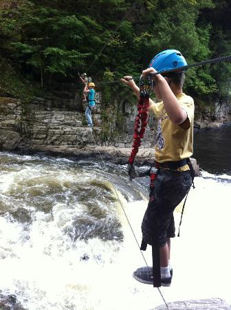 Canyon Sainte-Anne: Crossing the lower falls on a single wire