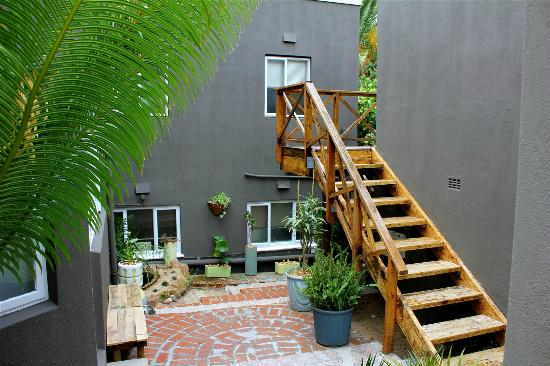 The Backpackers in Green Point: Patio and Stairs to Dorms