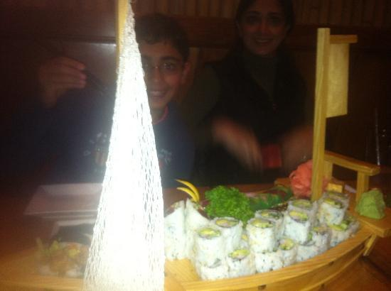 Aji Sushi Bar: Me and my son and a sushi boat