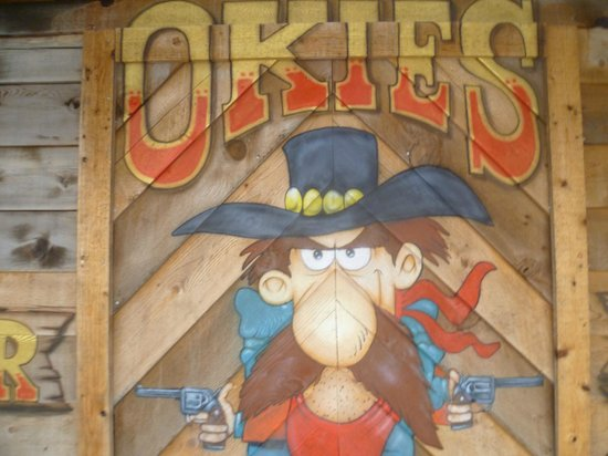 Okies Steakhouse & Saloon : Pass the cowboy to enter the restaurant!