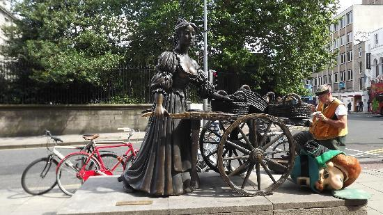 Grafton Street: Molly Malone addresses the other end of the street with a Leprechaun taking a break