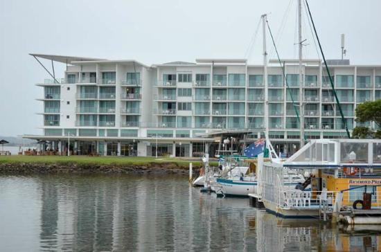 Ramada Hotel & Suites Ballina Byron: The Ramada Ballina, with small harbour next to it and Richmond River to the left.