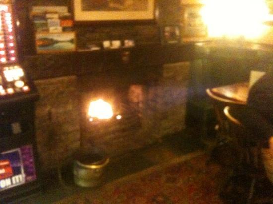 The Old John Peel Inn: lovely fire place