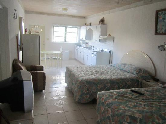 Tropical Dreams Rentals: View of beds and kitchen from the bathroom