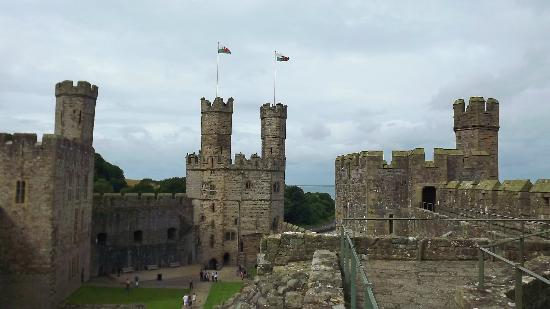 Caernarfon Castle The Flags Still Proudly Fly In Wales Picture Of