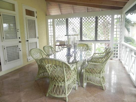 ‪‪Four Seasons Resort Nevis, West Indies‬: Screen porch dining area.‬