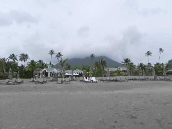 Four Seasons Resort Nevis, West Indies: View from the beach to the resort with Mt. Nevis in the background.