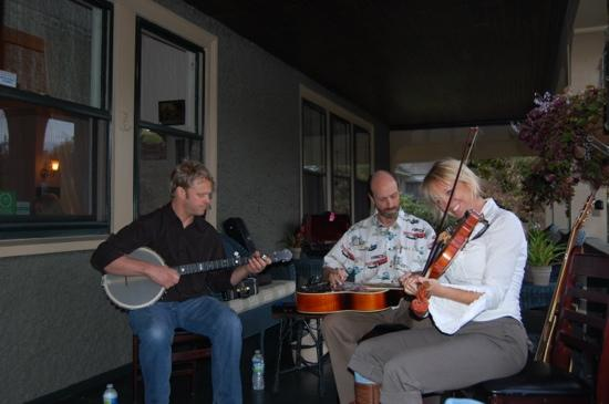 Wine, music and fun on the porch of 1900 Inn on Montford!