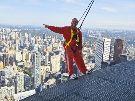 Edge Walk at the CN Tower : me pointing north towards our house