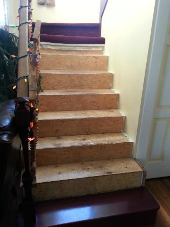 """Hughes' House Bed and Breakfast: Repaired stairs in """"no shoes"""" B&B"""