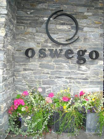 The Oswego Hotel: flowers beside front entrance of hotel