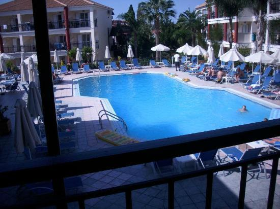 Planet Studios and Apartments: Swimming pool area from bar balcony