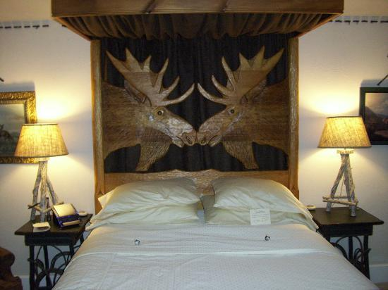 Lodge at Moosehead Lake : The headboard of the bed in the Moose Room