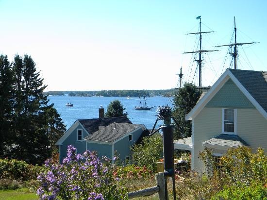 Topside Inn: View with mast of tall ship in harbor