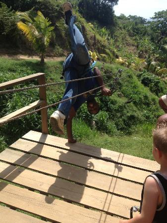 Jungle Top Zipline Adventure : Rafael doing a one-handed handstand into the zipline!