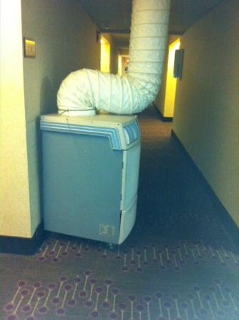 Hampton Inn Tampa International Airport / Westshore: Unit outside our door and several throughout the building. Corridors were stifling hot and humid