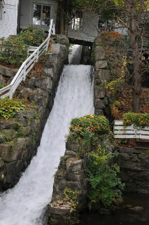 Mill Falls at the Lake: Water flowing beneath a hotel walkway, from an underground stream down to the lake