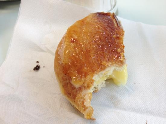 Kane's Donuts: Sorry about the bite but this crunchy Creme Brûlée donut was incredible!
