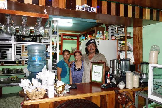 My Secret Deli: Proud owner with Tripadvisor Certificate and helpers