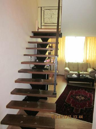 The Boutique Residence Hotel: stair to upstairs from front door of room