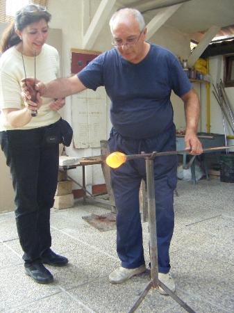 """Glass Factory Colleoni: wife """"helping"""" the Master glass artist...."""