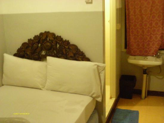 "Welcome Sawasdee Inn: single bed and 20"" to wall"