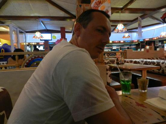 Falcon Creek Spur Steak Ranch: Hubby waiting for his ribs...
