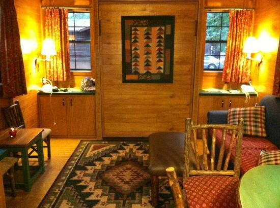 The Campsites at Disney's Fort Wilderness Resort: Living Room - The bed is hidden in the wall