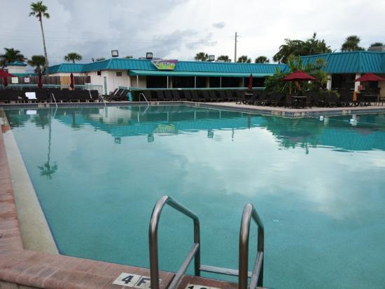International Palms Resort & Conference Center Cocoa Beach: The adult pool area and the Captain's Grill. The bar is on the right. The pool is large and warm