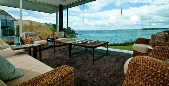 Hei Matau Lodge: View from one of the living rooms out over the pool and Hauraki Gulf