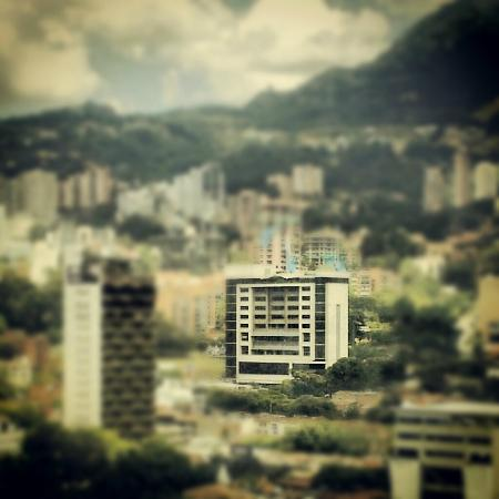 Diez Hotel Categoria Colombia: View of hotel with the rest of Poblado, blurred--nearby Charlee hotel is tower to left.