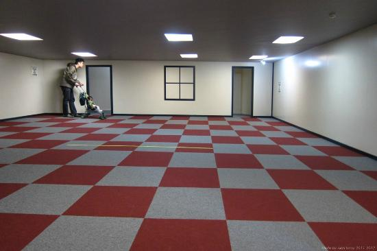 Puzzling World: At the Ames Room, me on the left - looking big