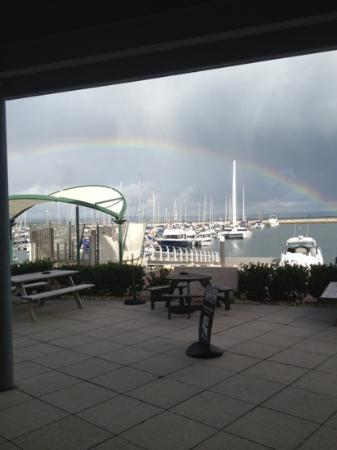 rainbow over the marina taken from the boat that rocks