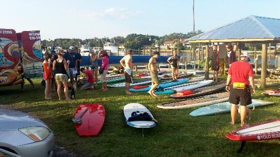 Urban Kai Stand-Up Paddleboarding : Large group for a paddle social.