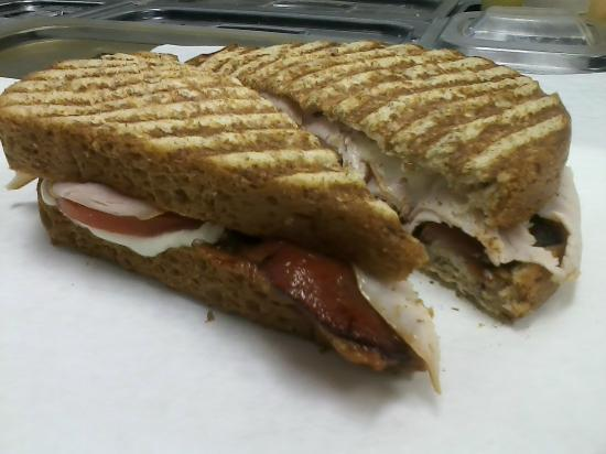 Hendersonville, TN: Hot Brown Panini~Smoked Turkey, Crisp Bacon, Sax Signature parmesan Cheese Spread, Sliced Tomato