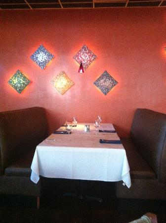 Mozaik: One of the dining areas along an artfully arranged lighted wall decorations