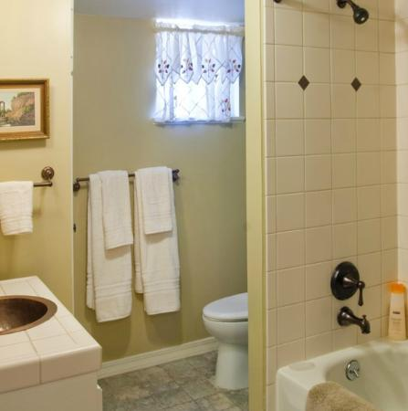 Enchanted Cottages: Bathroom in Hollyhock:copper dragonfly sink and great tile work/Romanian