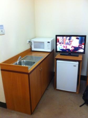 "Mercure Welcome Melbourne: ""kitchen"" with tv"