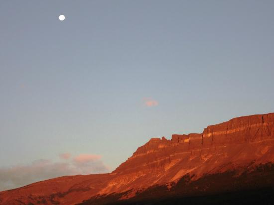 St Mary Lodge & Resort: Moon at sunrise, sun reflecting off the mountain top