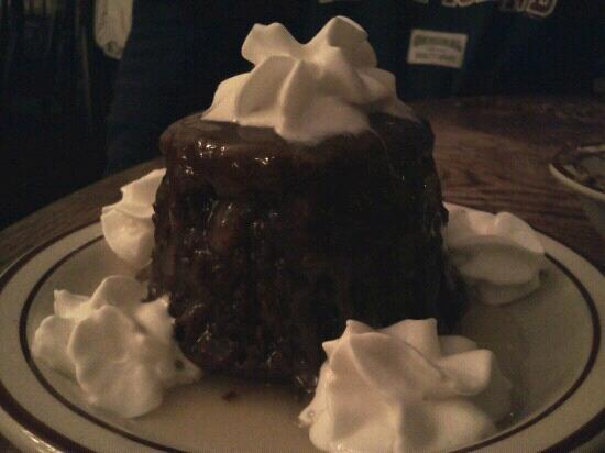 Beef & Brew: Homemade gingerbread cake with warm vanilla sauce and whipped cream.