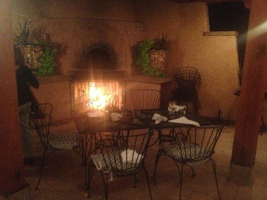 Farm and Table patio dining. Piñon and cedar fire!