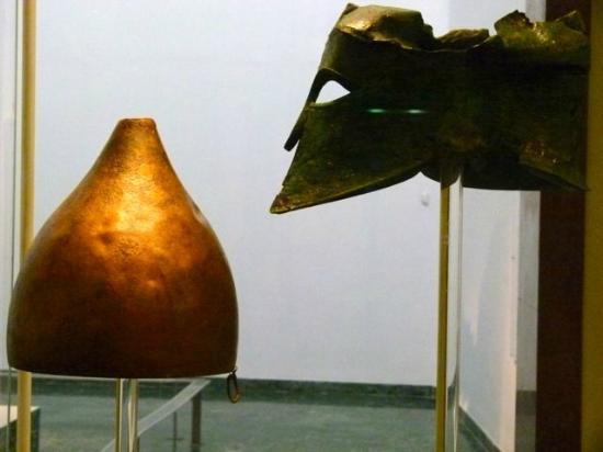 Katakolon Taxi - Ancient Olympia Day Tours: Persian conical helmet and Bronze Corinthian helmet.