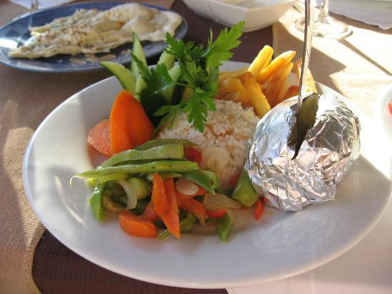 Angel Restaurant: Baked potato, chips, rice and vegetables on one plate.