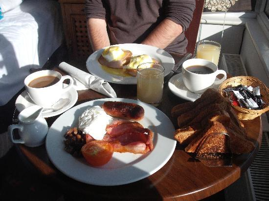 Sea Spray Boutique Hotel: Breakfast - full English (foreground) and Eggs Benedict (background)