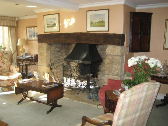 Fieldways: Drawing room fireplace, where a log fire is laid on chilly evenings.