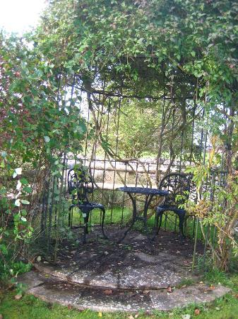 Fieldways: Secluded gazebo with wrought iron furniture.