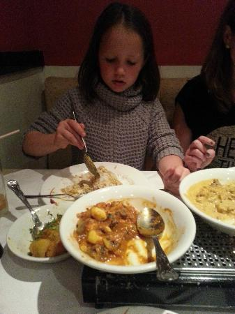 Roshni: Our youngest daughter demolishing a curry!