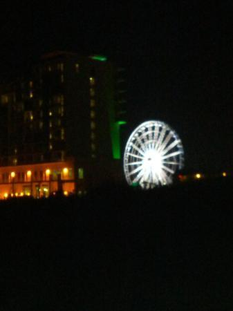 Days Inn Pensacola Beachfront: ferris wheel from beach looking back at motel holiday inn resort on left days inn on right