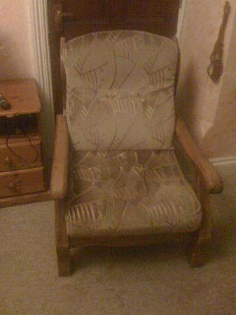 All Seasons Guest House: The chair that I didn't want to sit in...