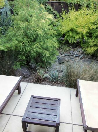 Gaige House + Ryokan, a Four Sisters Inn: the back porch view (a little green area)
